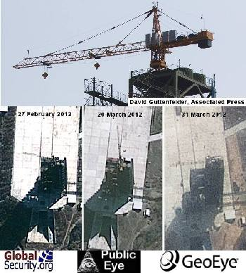 Details of the gantry in satellite imagery are hard to distinguish. Viewed up close, the crane is consistent with those found the world over.